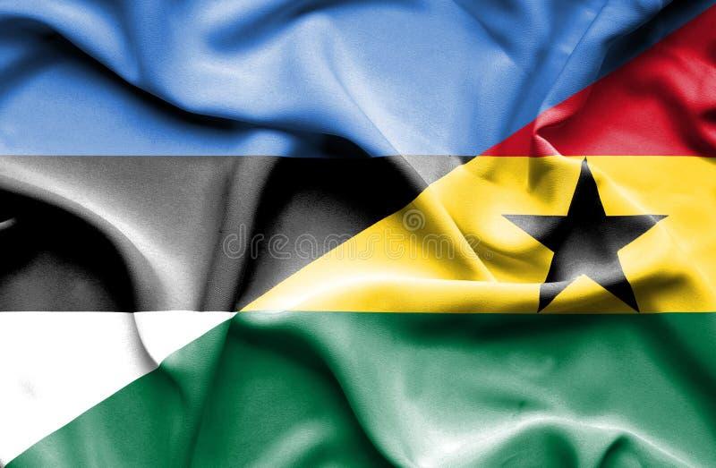 Развевая флаг Ганы и Эстонии стоковая фотография
