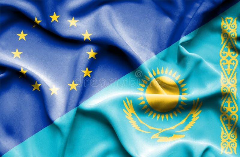 Развевая флаг Казахстана и ЕС стоковое фото rf