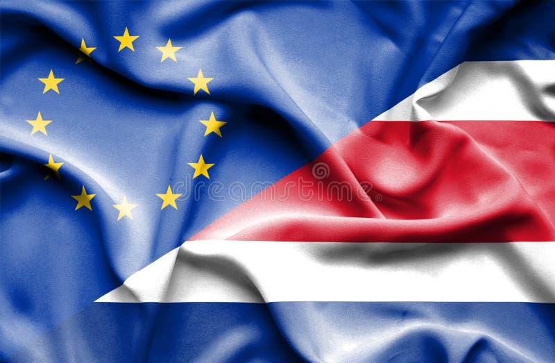 Развевая флаг Коста-Рика и ЕС стоковая фотография