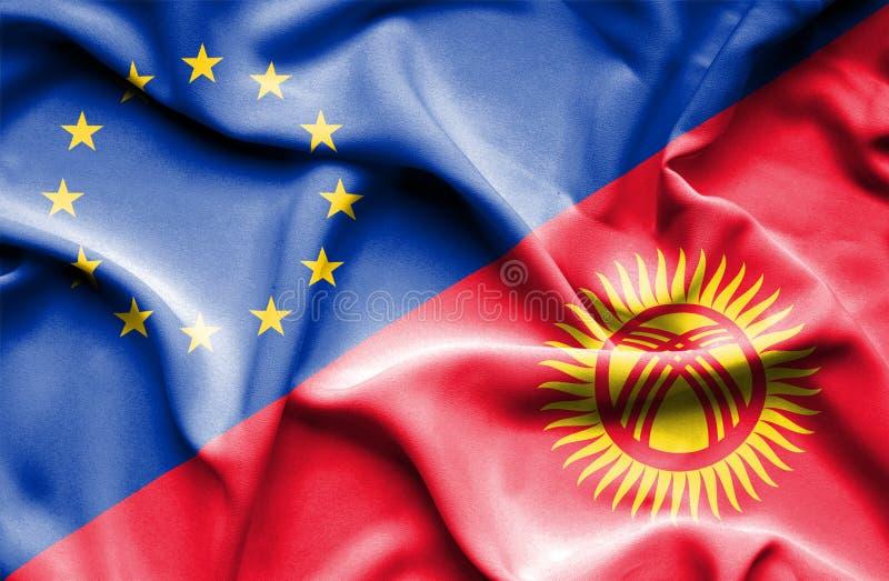 Развевая флаг Кыргызстана и ЕС стоковая фотография rf