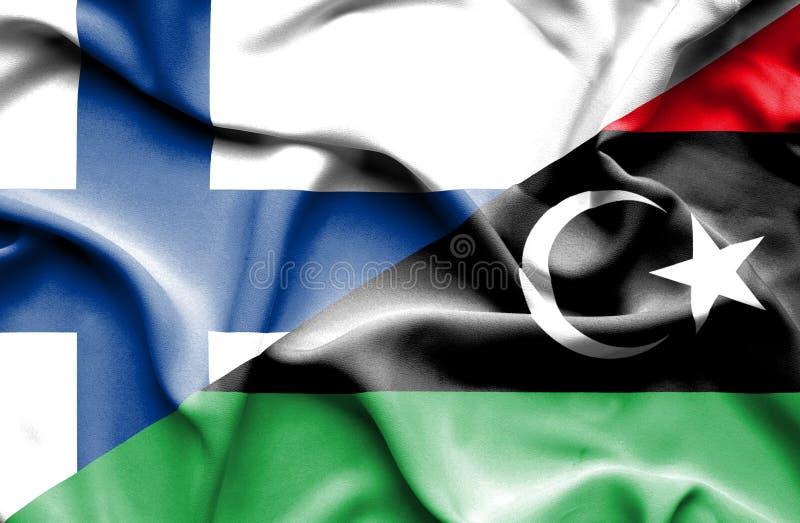 Развевая флаг Ливии и Финляндии стоковое фото rf