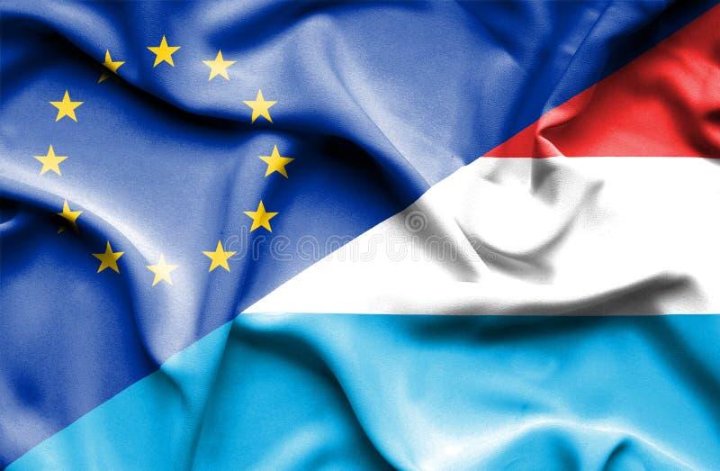Развевая флаг Люксембурга и ЕС стоковое изображение rf