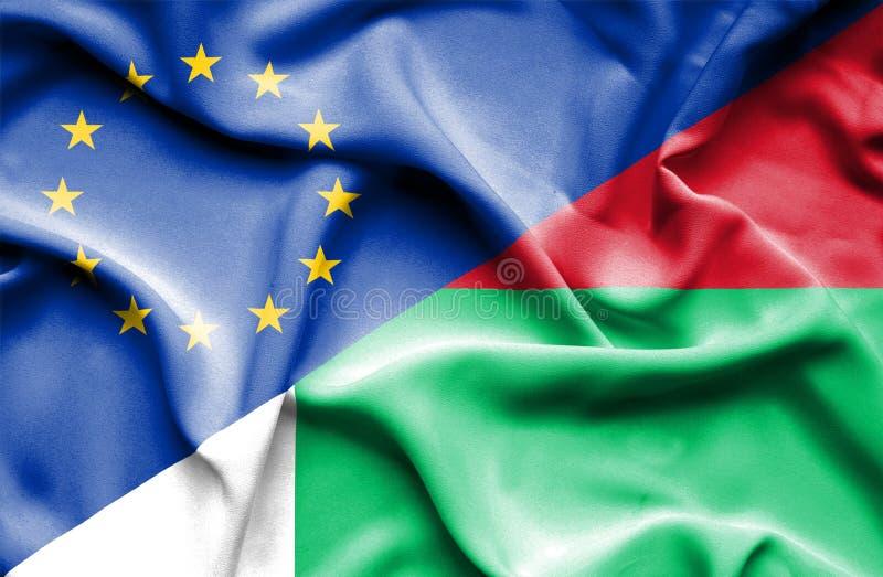Развевая флаг Мадагаскара и ЕС стоковые фотографии rf