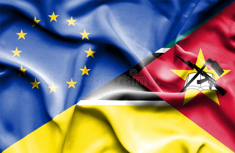 Развевая флаг Мозамбика и ЕС стоковые фото