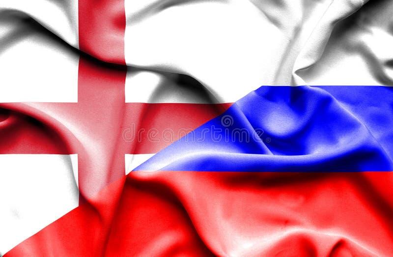Развевая флаг России и Англии стоковое фото rf