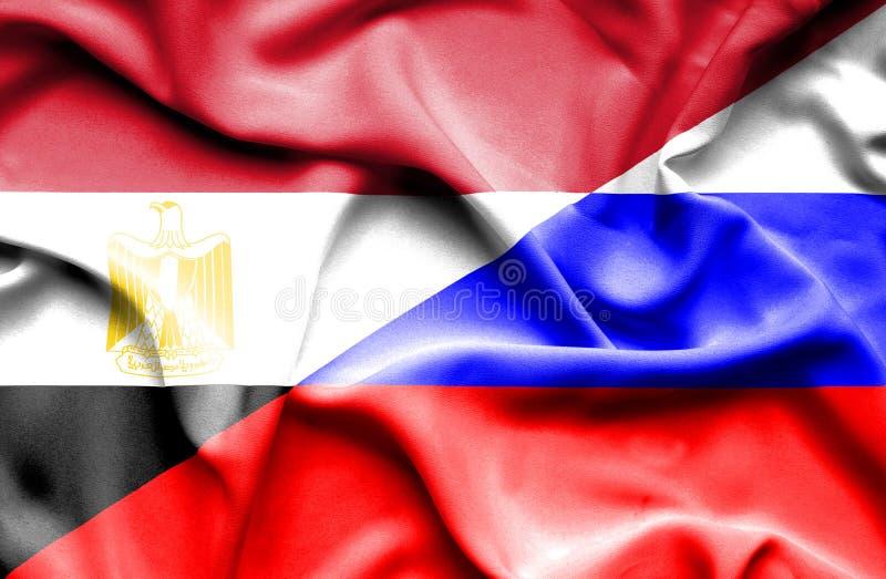 Развевая флаг России и Египта стоковые фото