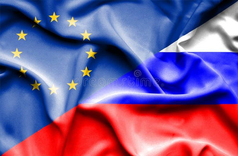 Развевая флаг России и ЕС стоковые фото