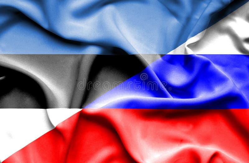 Развевая флаг России и Эстонии стоковое фото rf
