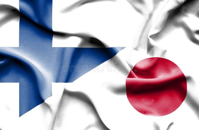Развевая флаг Японии и Финляндии стоковое изображение