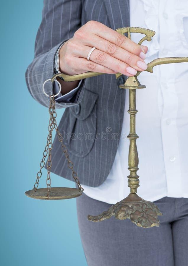 Раздел женского судьи средний с масштабами против голубой предпосылки стоковая фотография rf
