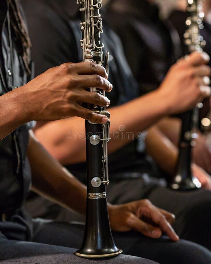 Раздел woodwind игрока кларнета стоковое изображение rf