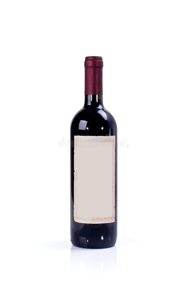 разлейте красное вино по бутылкам стоковое фото rf