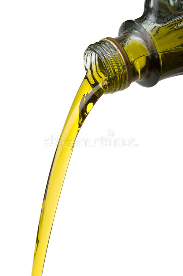 разлейте политую оливку по бутылкам масла стоковая фотография rf