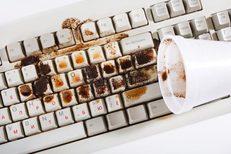 разливать клавиатуры кофе стоковые изображения rf