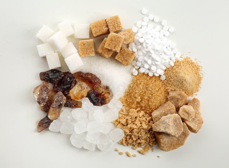 Различные виды сахара на белой предпосылке стоковое изображение