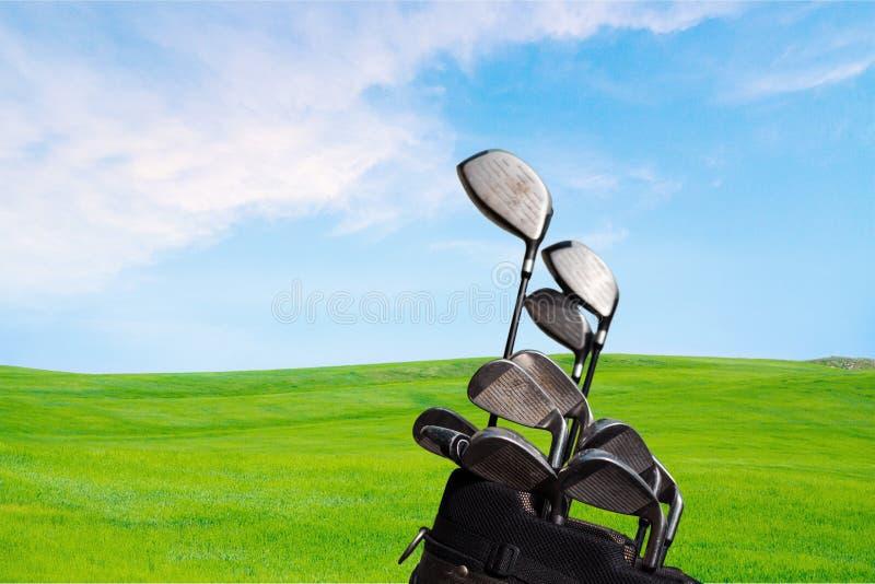 Различные гольф-клубы на запачканной предпосылке стоковая фотография rf