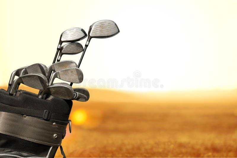 Различные гольф-клубы на предпосылке стоковые фотографии rf