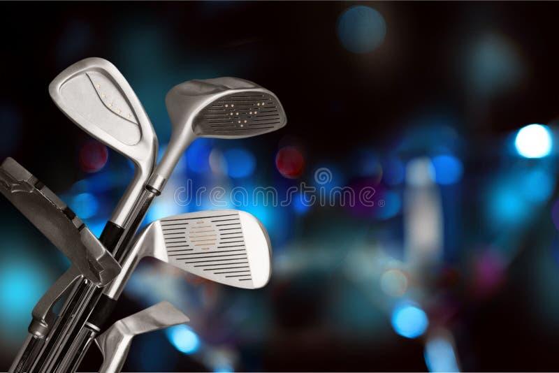 Различные гольф-клубы на предпосылке стоковые фото