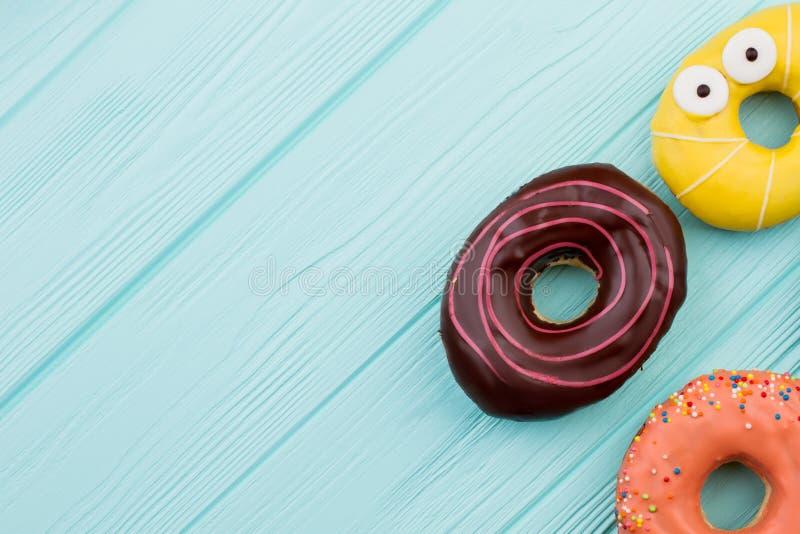 3 различных donuts и космоса экземпляра стоковые фото