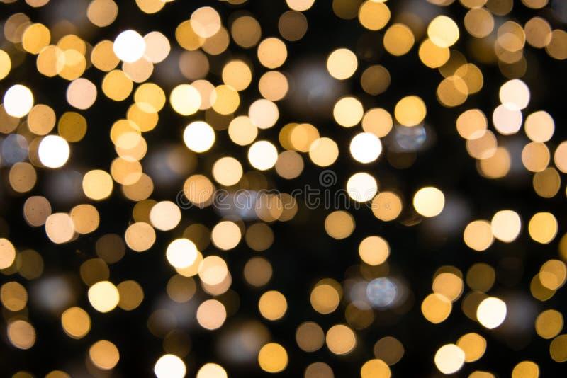 Размытый фон с золотыми бокскими кругами света стоковые изображения