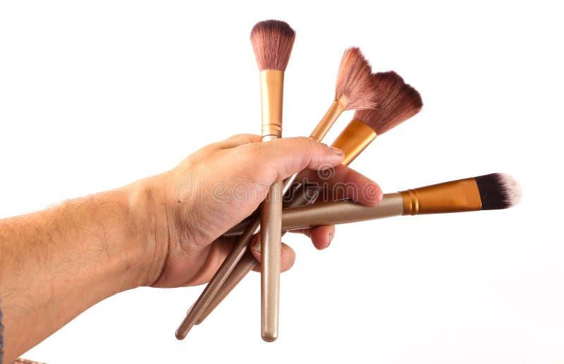 Разнообразие владением руки щеток состава стоковое фото