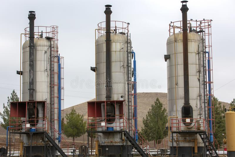 Разные виды боилеров используемых в нефтедобывающей промышленности стоковая фотография