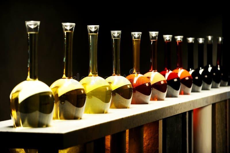 Различные виды вина в специальных бутылках стоковое изображение rf