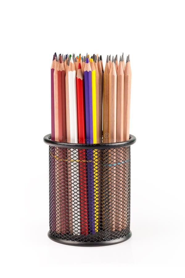 Различные карандаши в изолированном контейнере решетки металла стоковые изображения rf