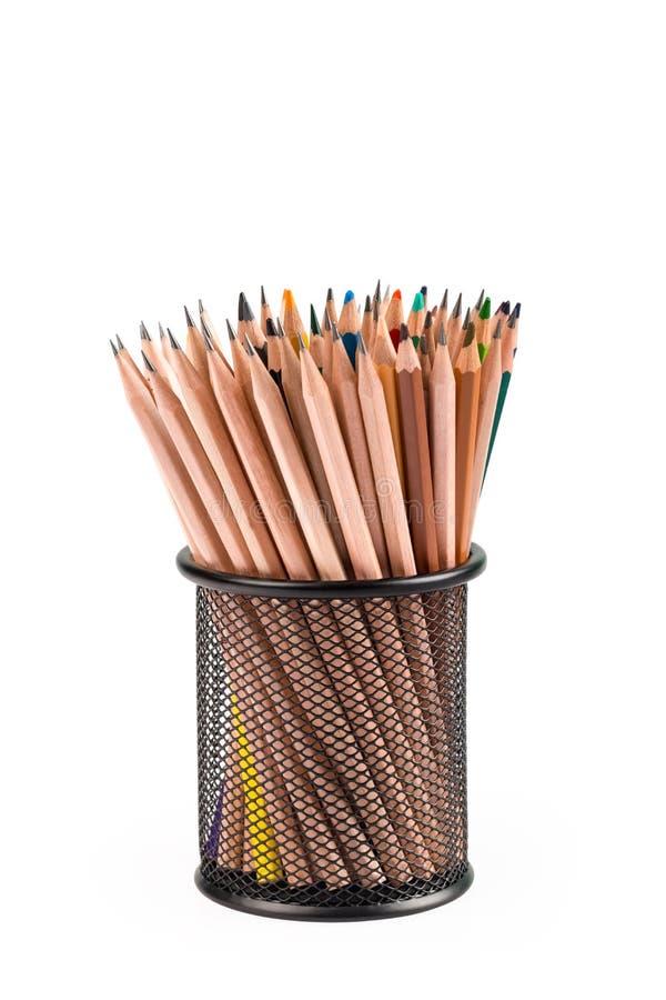 Различные карандаши в контейнере решетки металла стоковые фото