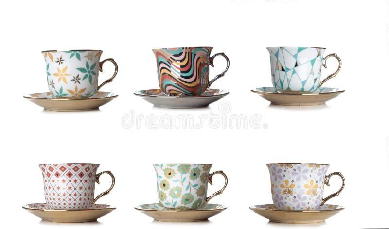 Различные чашки кофе, чай на белой предпосылке стоковое изображение