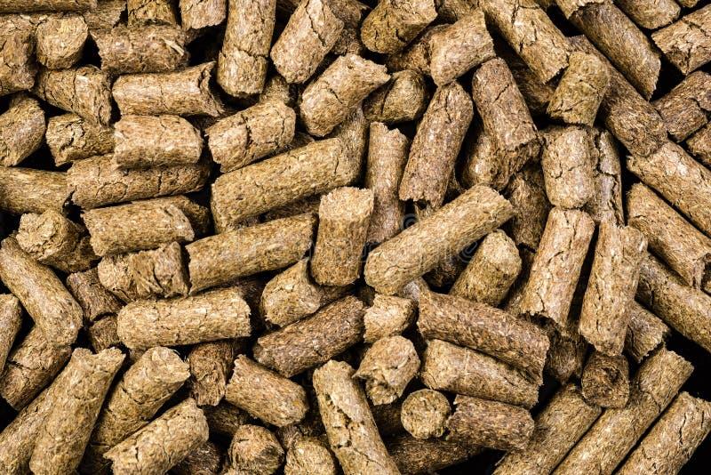 Раздробленная текстура предпосылки корма для животных стоковые изображения rf