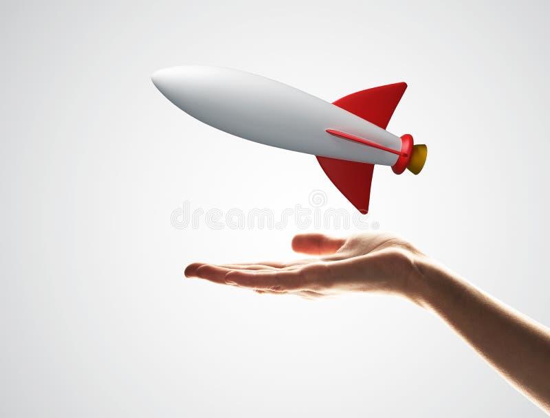 Ракета в руке как символ для высоких технологий и науки стоковые изображения