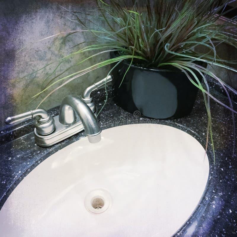 Раковина ванной комнаты украшенная с заводом стоковое изображение rf
