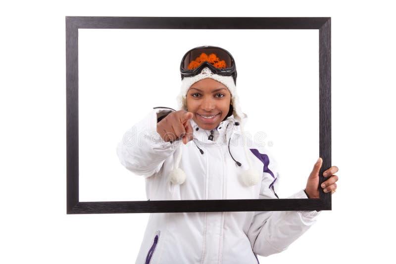 рамка зацепляет детенышей женщины лыжи изображения удерживания стоковое изображение rf