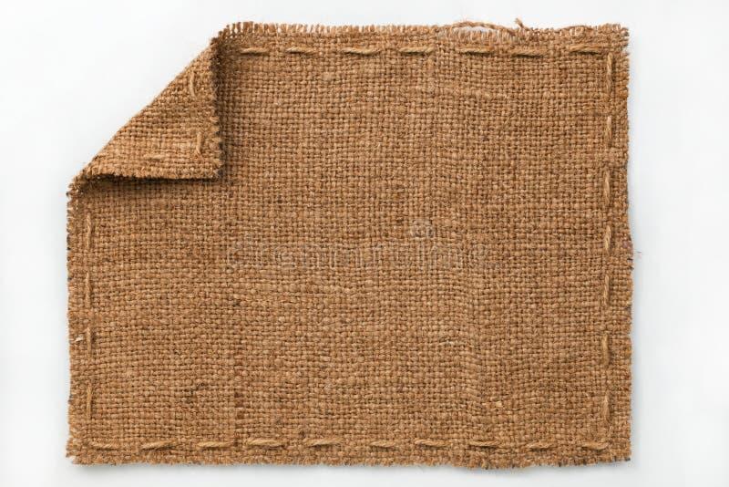 Рамка мешковины с загнутыми кромками, лож на белой предпосылке стоковое изображение rf