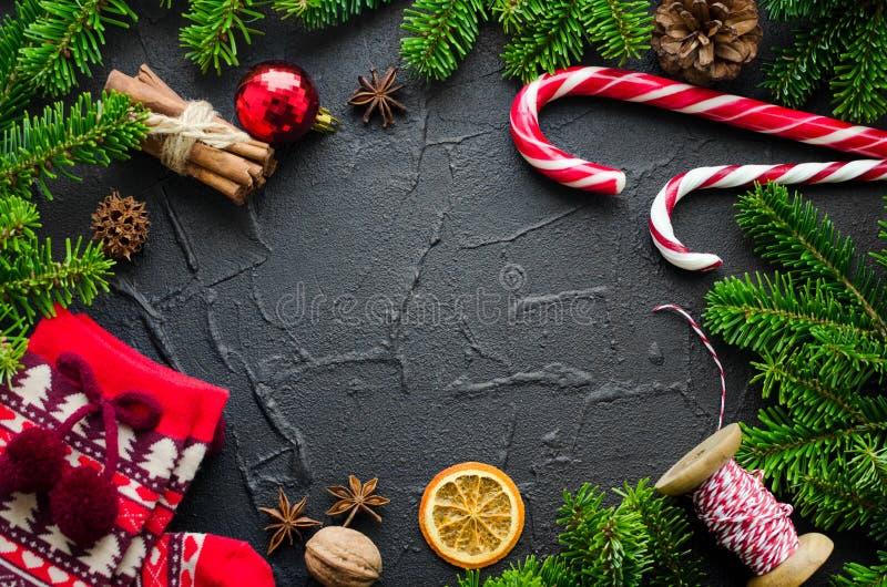 Рамка рождества на черной предпосылке стоковая фотография rf