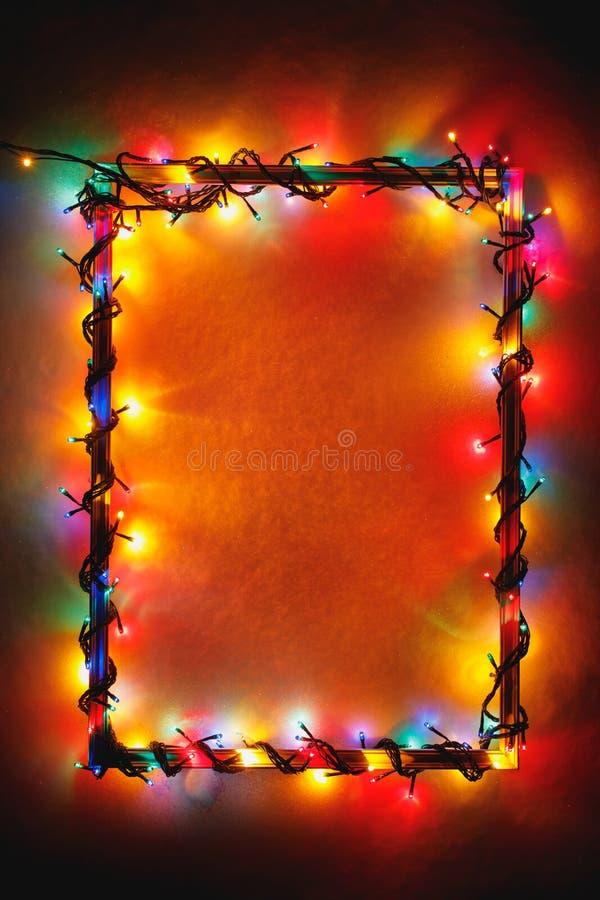 Рамка светов рождества на деревянной предпосылке стоковое изображение rf
