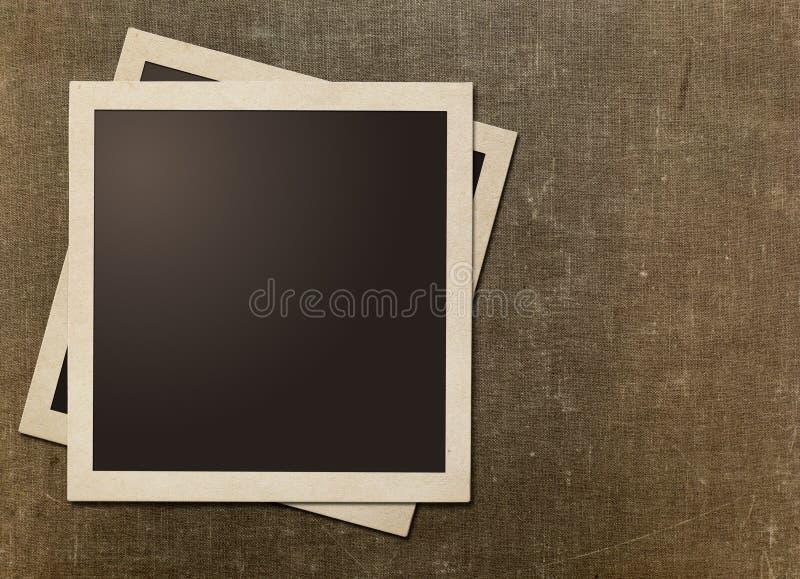 Рамки старого немедленного фото поляроидные на холсте grunge стоковые фото