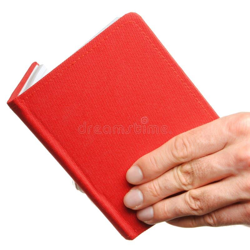 Раскрытая книга в руке стоковые изображения rf