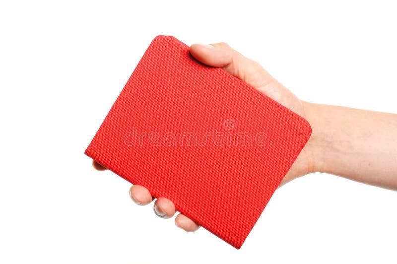 Раскрытая книга в руке стоковые изображения