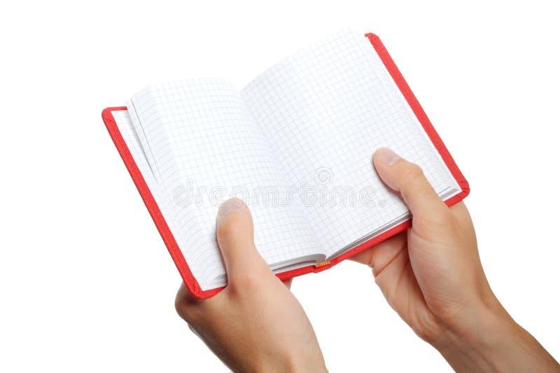 Раскрытая книга в руке стоковые фотографии rf