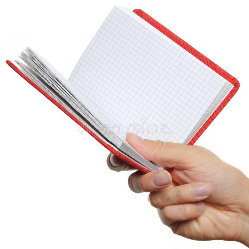 раскрытая рука книги стоковые изображения rf