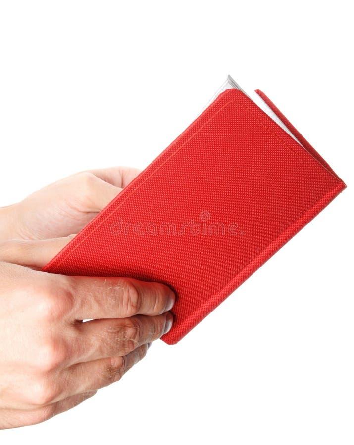 раскрытая рука книги стоковые изображения