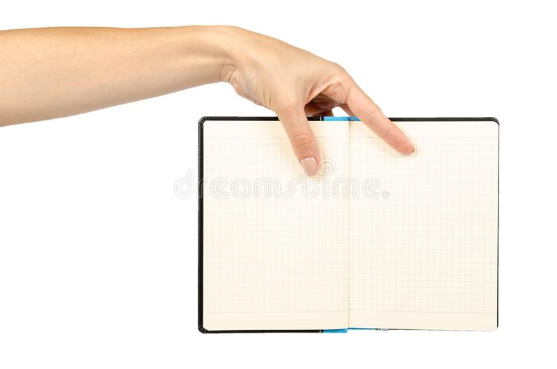 Раскрытая черная тетрадь при рука, изолированная на белой предпосылке стоковая фотография rf
