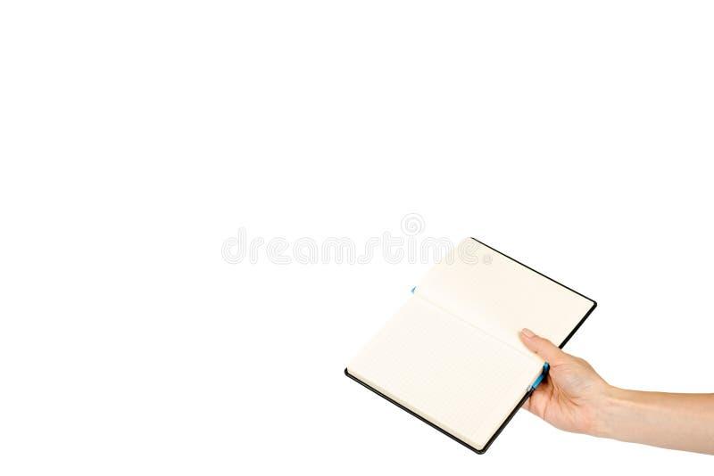 Раскрытая черная тетрадь при рука, изолированная на белой предпосылке, шаблон космоса экземпляра стоковая фотография
