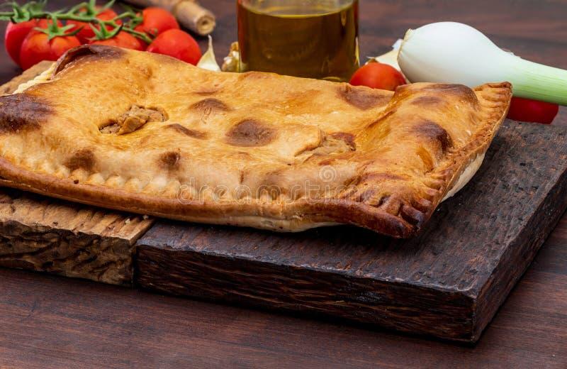 Расстегай тунца Типичное блюдо Галиция и Испания галичанина С естественными ингридиентами стоковые изображения rf