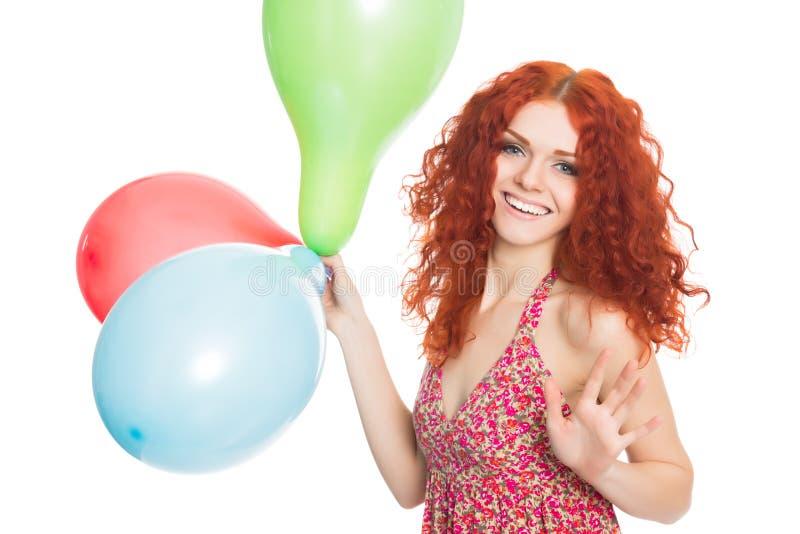 Радостная девушка держа красочные воздушные шары стоковое изображение rf