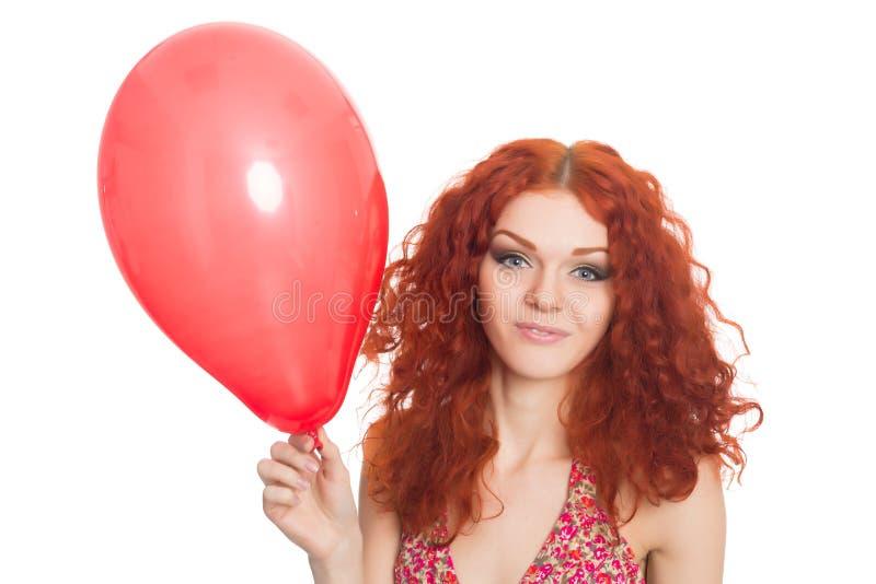 Радостная девушка redhead держа воздушный шар стоковое изображение rf