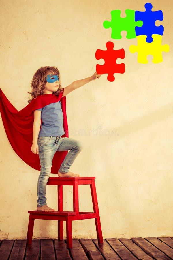 Ребенк супергероя стоковое изображение