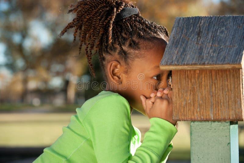 ребенок афроамериканца шаловливый стоковое изображение rf
